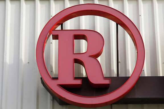 "This March 25, 2014 photo shows signage at a RadioShack store in Philadelphia. RadioShack Corp. CEO Joseph Magnacca said in a statement on Thursday, Sept, 11, 2014, that the consumer electronics company is actively exploring options for overhauling its balance sheet and is in advanced talks with ""a number of parties."" (AP Photo/Matt Rourke)"