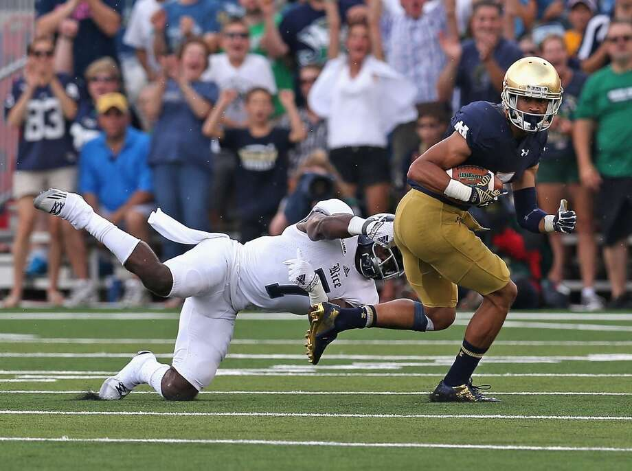 SOUTH BEND, IN - AUGUST 30:  Will Fuller #75 of the Notre Dame Fighting Irish breaks away from Juluis White III # 7 of the Rice Owls for a 75 yard touchdown play at Notre Dame Stadium on August 30, 2014 in South Bend, Indiana.  (Photo by Jonathan Daniel/Getty Images) Photo: Jonathan Daniel, Getty Images
