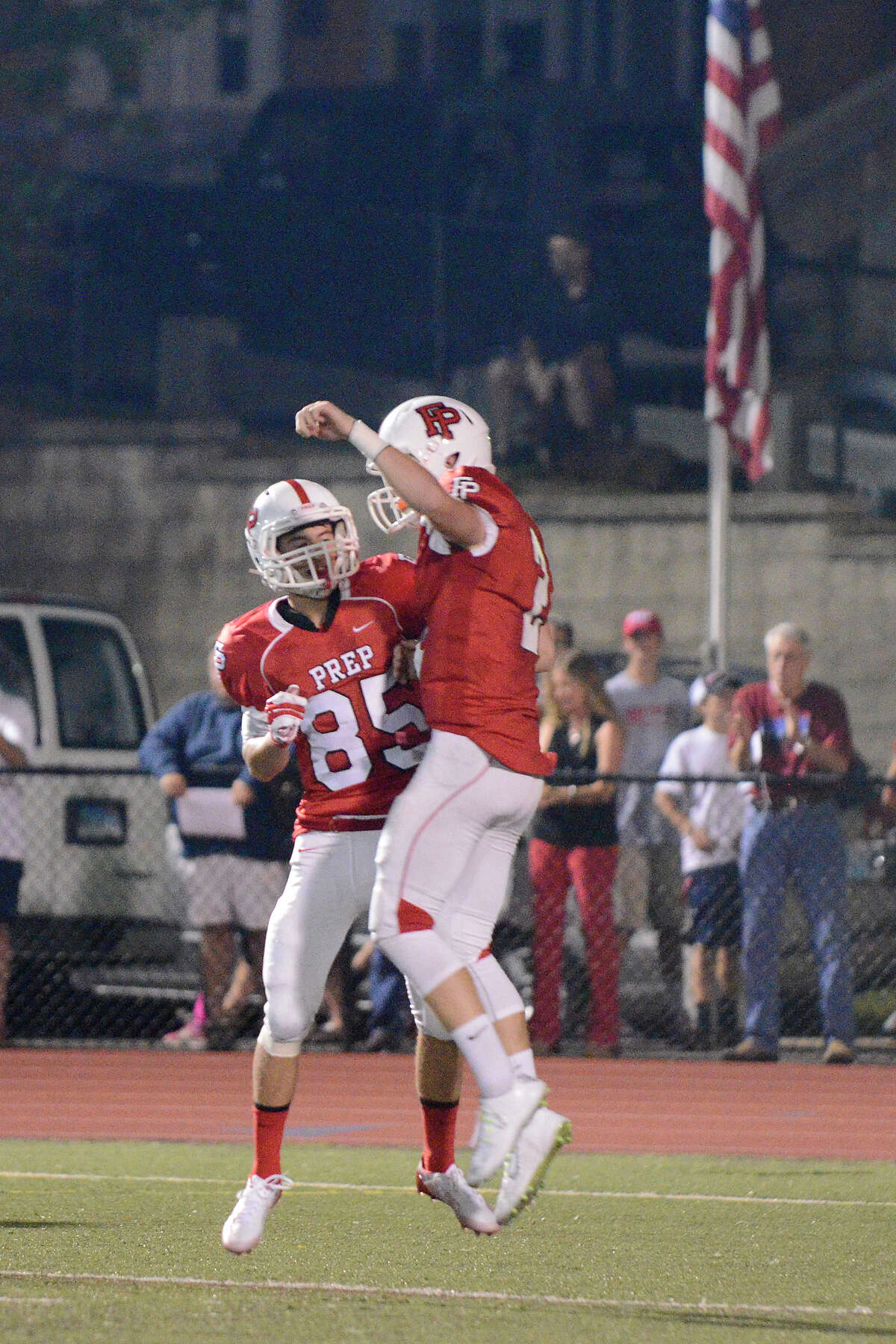 Prep's Ben Kelly congratulates teammate Colton Smith on a first half touchdown as Stamford High School challenges Fairfield Prep at Fairfield Ludlowe High School in high school varsity football action on Thurs. Sept. 11, 2014.