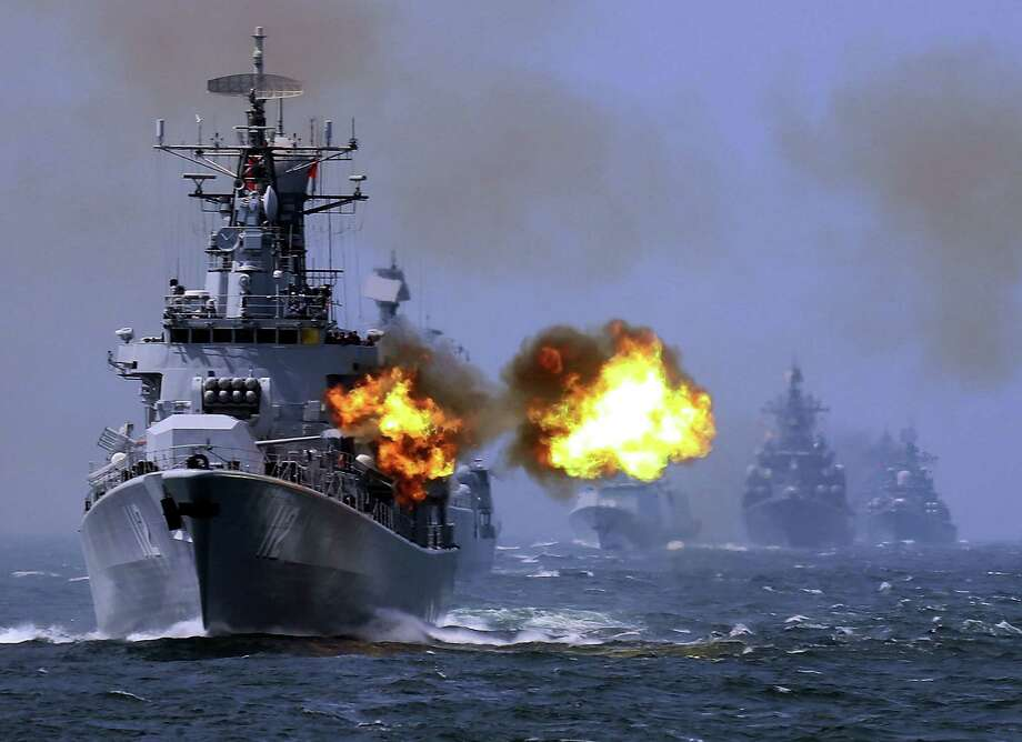 "China's Harbin guided missile destroyer (No. 112) takes part in the weeklong China-Russia ""Joint Sea — 2014"" naval exercise in the East China Sea earlier this year. Photo: Associated Press / CHINATOPIX"