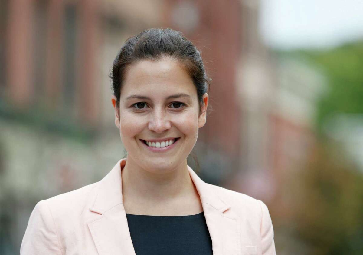 Republican Congressional candidate Elise Stefanik poses on Wednesday, Aug. 27, 2014, in Ballston Spa, N.Y. Stefanik is running for a House seat in northern New York. (AP Photo/Mike Groll) ORG XMIT: NYMG203