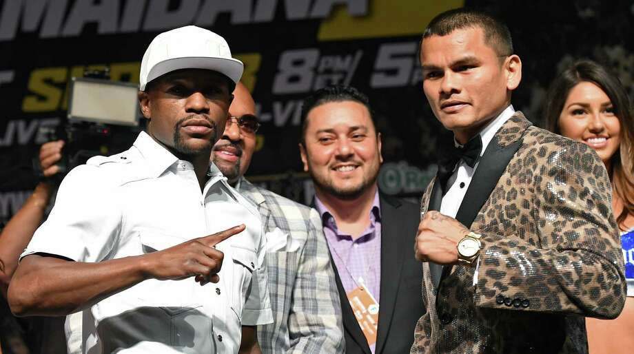 """Floyd Mayweather Jr. (left) and Marcos Maidana pose for the cameras during the pre-fight news conference on Thursday in Las Vegas. Maidana said he hopes to fight """"fresher"""" in the rematch. Photo: Ethan Miller / Getty Images / 2014 Getty Images"""