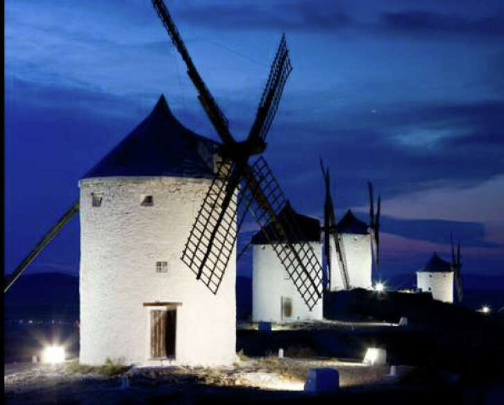 """Grinding flour in windmills is part of the annual Saffron Rose Fiesta in Consuegra, Spain, which celebrates the culture of the landscape best known from """"Don Quixote."""""""