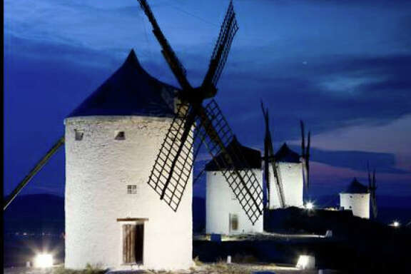 "Grinding flour in windmills is part of the annual Saffron Rose Fiesta in Consuegra, Spain, which celebrates the culture of the landscape best known from ""Don Quixote."""