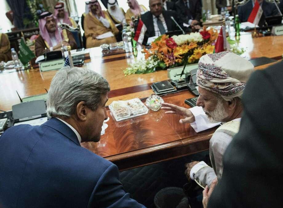 Oman Foreign Minister Yusuf bin Alawi bin Abdullah (right) and U.S. Secretary of State John Kerry talk in Saudi Arabia. Photo: Brendan Smialowski / Associated Press / POOL AFP