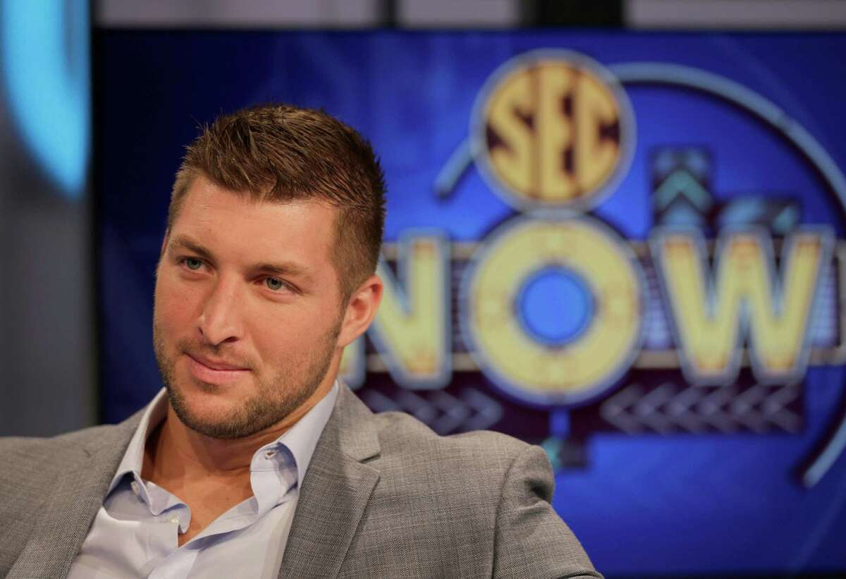 """FILE - In this Aug. 6, 2014 file photo, Tim Tebow answers a question during a interview on the set of ESPN's new SEC Network in Charlotte, N.C. Tebow is taking the field for """"Good Morning America."""" ABC said the Heisman Trophy winner is joining the program as a contributor starting Monday, Sept. 15, 2014. (AP Photo/Chuck Burton, file) ORG XMIT: CAET720"""