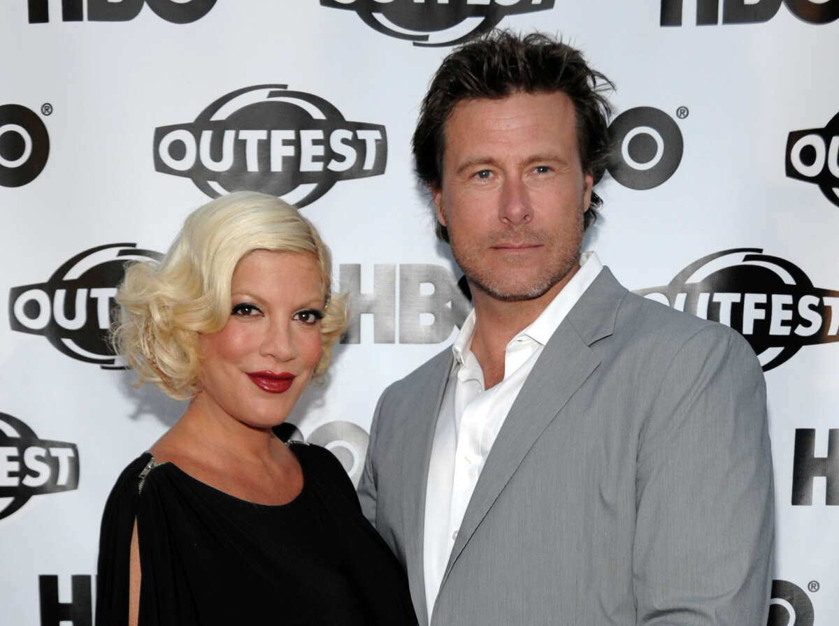 """FILE - In this July 7, 2011 file photo, actress Tori Spelling, left, and actor Dean McDermott arrive at the premiere of the feature film """"Gun Hill Road"""" in Los Angeles. Spelling is willing to go there for a second time. Lifetime says filming began Thursday, Sept. 11, 2014, on another season of ?""""True Tori.?"""" (AP Photo/Dan Steinberg, file) ORG XMIT: CAET717"""