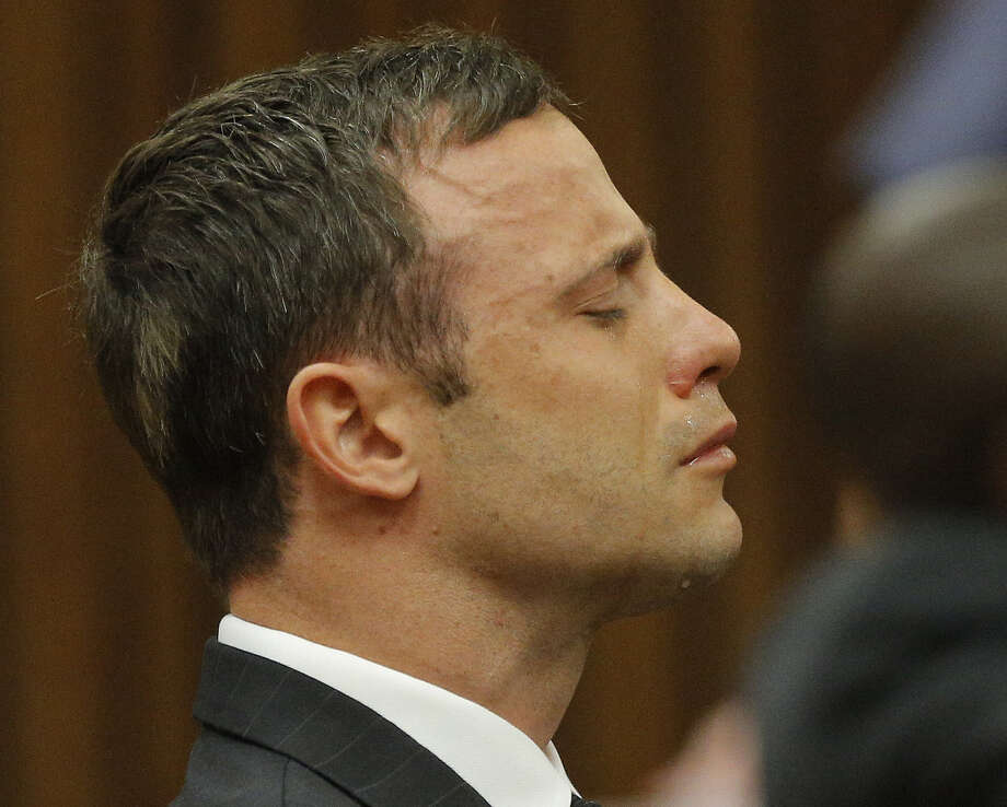 Tears roll down Paralympic athlete Oscar Pistorius' face as he reacts to Judge Thokozile Matilda Masipa delivering a not-guilty verdict to a charge of murdering his girlfriend. Photo: Kim Ludbrook / Associated Press / POOL EPA