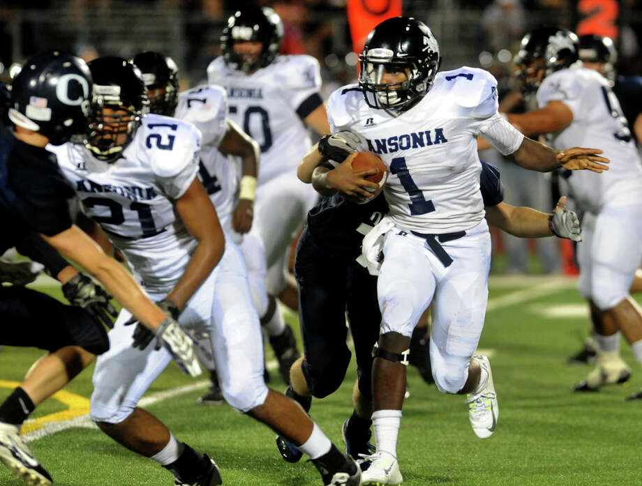Ansonia's Jai'Quan Mcknight carries the ball, during high school football action against Oxford in Oxford, Conn., on Thursday Sept. 11, 2014. Photo: Christian Abraham / Connecticut Post