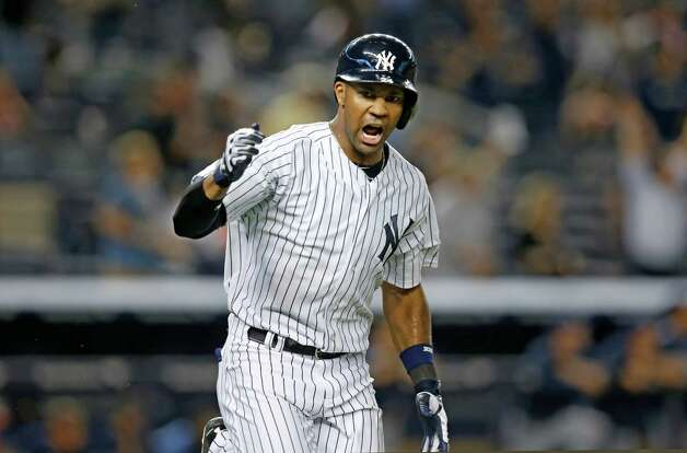 New York Yankees  Chris Young reacts after hitting a ninth-inning, walk-off, three-run home run to lift the Yankees to a 5-4 victory over the Tampa Bay Rays in a baseball game at Yankee Stadium in New York, Thursday, Sept. 11, 2014. (AP Photo/Kathy Willens) ORG XMIT: NYY125 Photo: Kathy Willens / AP