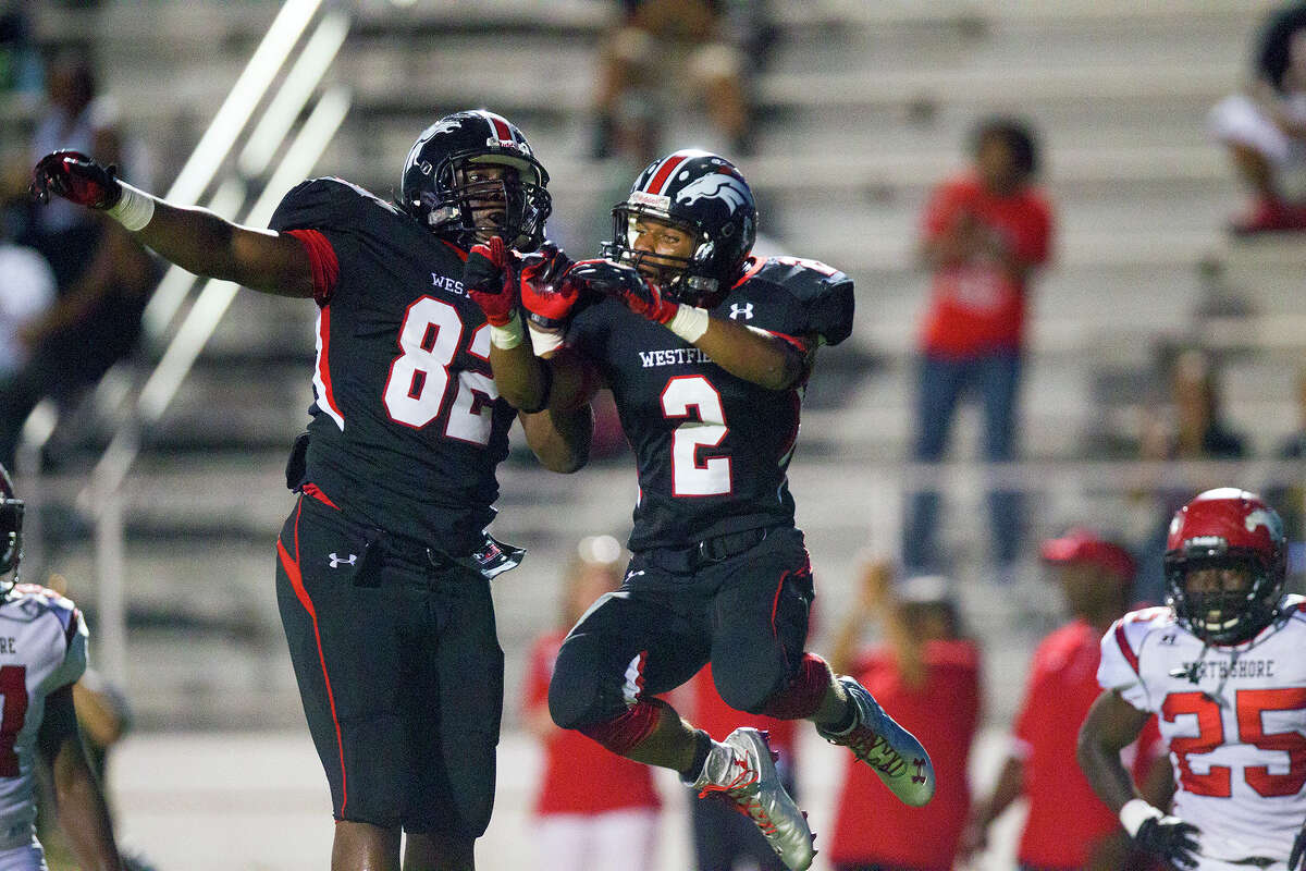 Westfield High School's Latevius Downs, right, celebrates with a teammate after scoring a touchdown against North Shore during the first half of their matchup at Leonard George Stadium, Thursday, Sept. 11, 2014, in Spring. (Cody Duty / Houston Chronicle)