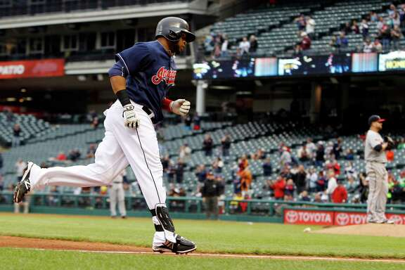 The Indians' Carlos Santana rounds the bases after hitting a home run - his second of the day - in the finale of Thursday's doubleheader against the Twins.