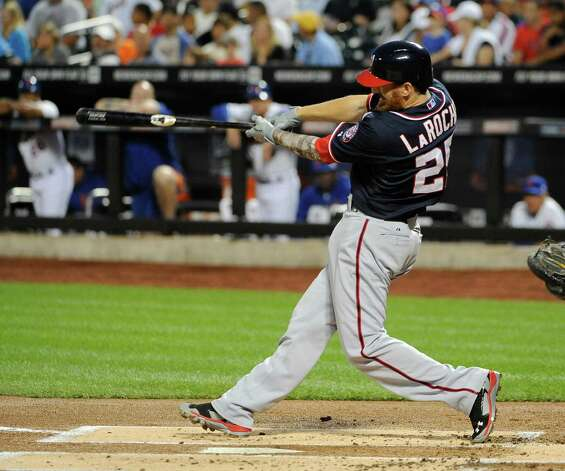 Washington Nationals' Adam LaRoche hits a two-run home run off of New York Mets starting pitcher Bartolo Colon in the first inning of a baseball game Thursday, Sept. 11, 2014, in New York. (AP Photo/Kathy Kmonicek) ORG XMIT: NYM107 Photo: Kathy Kmonicek / FR170189 AP