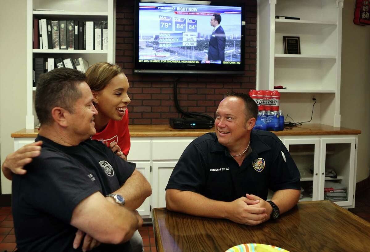 HFD engine operator Joe Hernandez and engine operator Anthony Reynolds great H-E-B partner Lacey Dalcour greets firefighters during the Helping Heroes breakfast for brave firefighters on Wednesday, Sept. 10, 2014, in Houston.