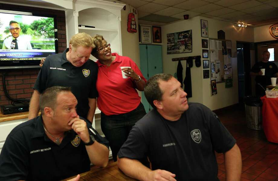 Firefighter Michael Thompson is greeted by Sheila Jackson while H-E-B celebrates the 10th year of Helping Heroes where they provide breakfast for brave firefighters on Wednesday, Sept. 10, 2014, in Houston.  This community project honors September 11th as a National Day of Service and Remembrance that pays tribute to the men and women of the rescue teams who risked and lost their lives at the World Trade Center. H-E-B presented a check of $15,000 to the Houston 100 Club. Photo: Mayra Beltran, Houston Chronicle / © 2014 Houston Chronicle