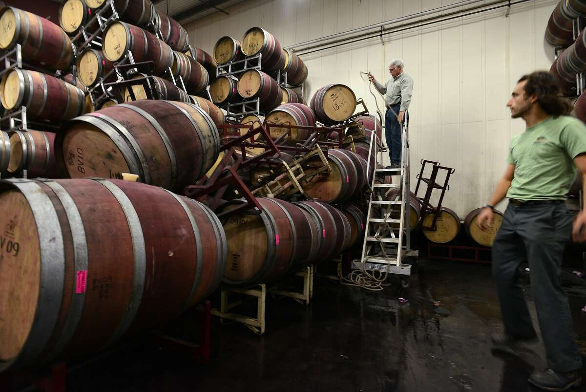 Associate winemaker Andrew Brooks, right, and General Manager and Head Winemaker Michael Richmond of Bouchaine winery in Napa working on the clean up in Bouchaine's barrel room from Sunday morning's 6.0 earthquake. The quake left the barrel room ankle deep in wine when employees first came to assess the damage. August 25, 2014.ees first came to assess the damage. August 25, 2014.