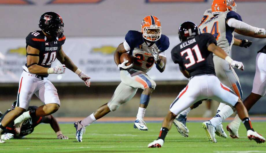 Texas Tech's run defense gave up 147 yards to UTEP's Aaron Jones last week. Saturday, the defense goes against an Arkansas line averaging 321 pounds per man. Photo: John Weast / Getty Images / 2014 Getty Images