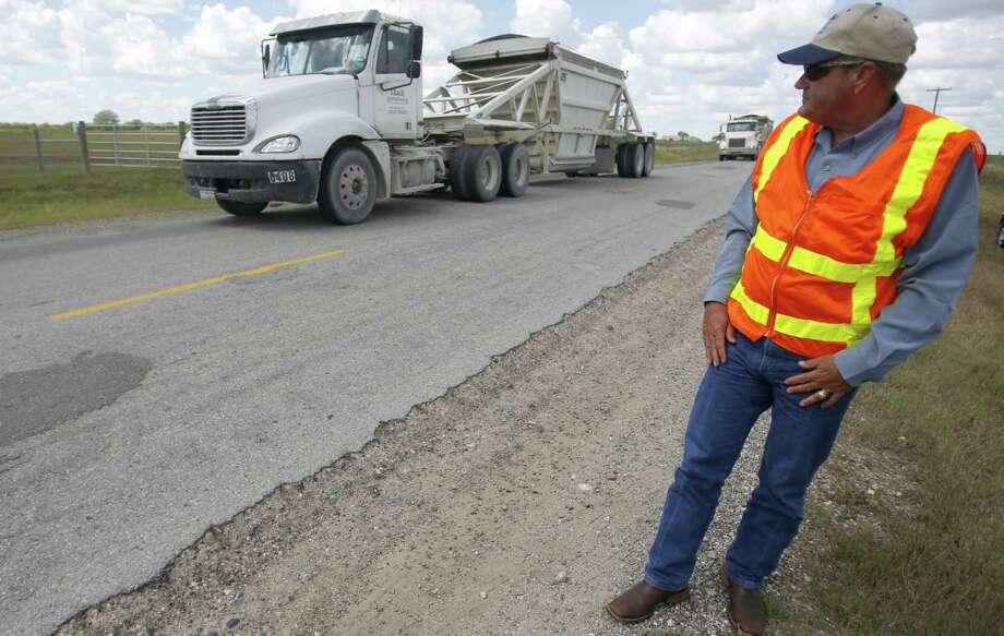 TxDOT's executive director, retired Lt. Gen. Joe Weber, watches trucks in Karnes County. Photo: William Luther / San Antonio Express-News / © 2013 San Antonio Express-News