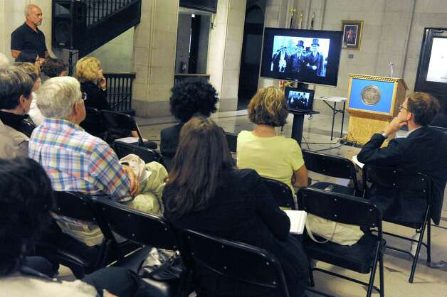 "A lunchtime group watches a special preview of the new Ken Burns Documentaries film, ""The Roosevelts: An Intimate History,"" Thursday, Sept. 11, 2014, at City Hall in Albany, N.Y. (Michael P. Farrell/Times Union) Photo: Michael P. Farrell / 00028460A"