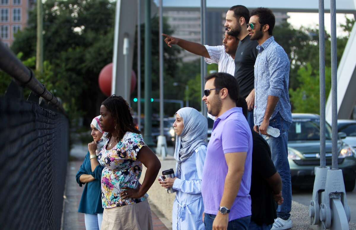 Onlookers view the traffic on the Southwest Freeway after an 18-wheeler erupted in flames near Spur 527 on Sept. 12, 2014.