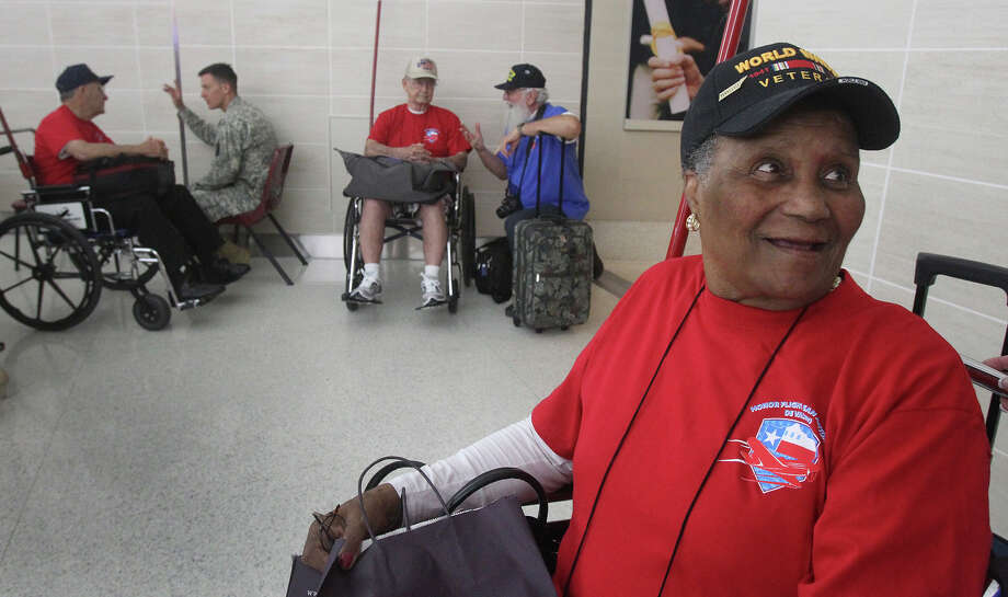 World War II veteran Rose Witherspoon Spence,91, (right) prepares Friday September 12, 2014 to board a flight that will take her and other veterans to see the National World War II Memorial in Washington D.C. . Spence and other veterans went on the trip arranged by Honor Flight San Antonio de Valero. Photo: JOHN DAVENPORT, San Antonio Express-News / ©San Antonio Express-News/John Davenport