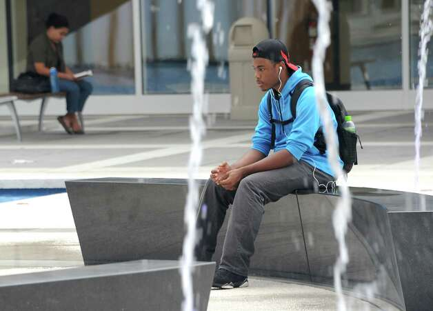 Freshman Stephon Mehu of Rockland County takes a break in between classes to listen to some music while sitting on a bench in the new fountain at UAlbany on Thursday, Sept. 11, 2014 in Albany, N.Y. (Lori Van Buren / Times Union) Photo: Lori Van Buren, Albany Times Union