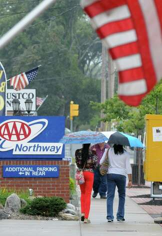 People use umbrellas during some light rain along Union St. on Thursday, Sept. 11, 2014 in Schenectady, N.Y. (Lori Van Buren / Times Union) Photo: Lori Van Buren, Albany Times Union