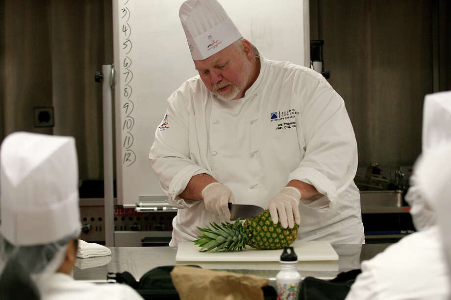 Chef Will Thornton, a professor of culinary arts at St. Philip's College, goes over the process of cutting a pineapple Sept. 10, 2014 as he explains to students his steps of first cutting off the top and the bottom and then cutting off the sides, getting the core out and then slicing what is left to how ever you like. Photo: For The San Antonio Express-News / For the San Antonio Express-News