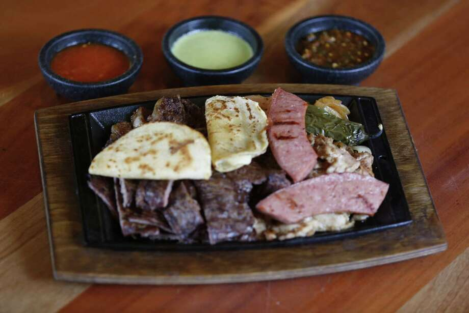 This parrillada, or mixed grill, includes arrachera (fajita meat), chicken, beef rib, sausage, chicken and a pair of quesadillas. It serves two people. Photo: Photos By William Luther / San Antonio Express-News / © 2013 San Antonio Express-News