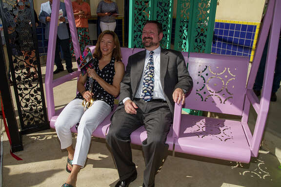 """(Left to right) Councilwoman Shirley Gonzales and Jeff Arndt, CEO of VIA Metropolitan Transit, sitting in a porch swing in the new """"Urban Porch"""" bus shelter on Brazos Street, Friday, Sept. 12, 2014."""