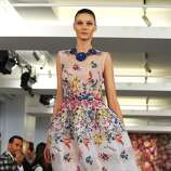 In this Tuesday, Sept. 9. 2014, file photo, the Oscar de la Renta Spring 2015 collection is modeled during Fashion Week in New York. (AP Photo/Diane Bondareff, File)