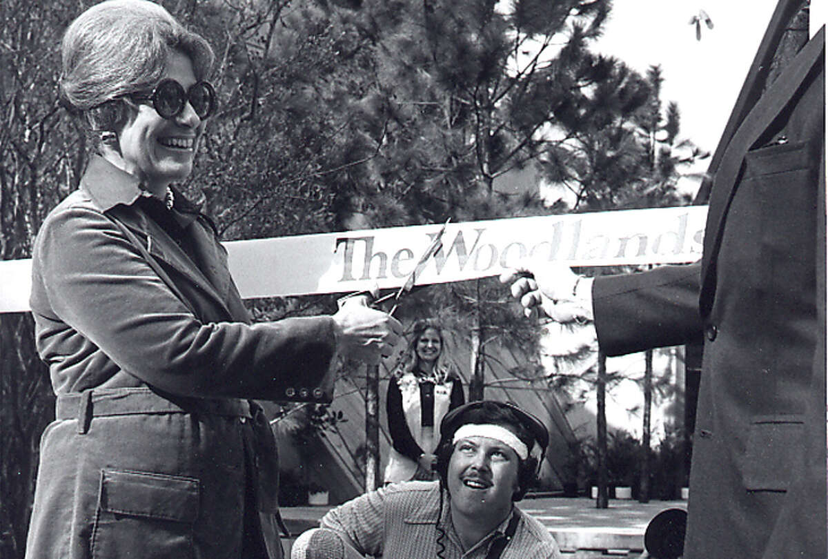 Cynthia Woods Mitchell cuts the ribbon marking opening day in The Woodlands on October 19, 1974. See other photos of The Woodlands beginning.