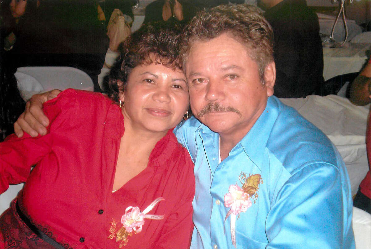 This family photo shows Vilma Marenco and her husband Guillermo Gomez at a party together. Marenco was killed in April when her car was crushed in an accident involving an unlicensed, uninsured truck owned by a company that was operating illegally in Houston, state police, court and inspection reports show.