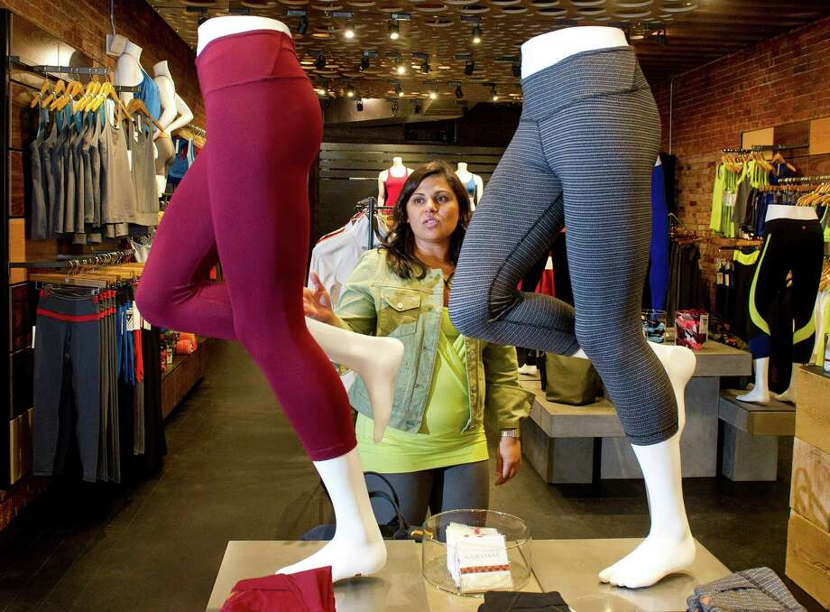 Tapasya Bali, co-founder of YOGASMOGA, shows off the details of the company's clothing at their new Greenwich location at 68 Greenwich Ave. on Friday, September 12, 2014. Photo: Lindsay Perry / Stamford Advocate