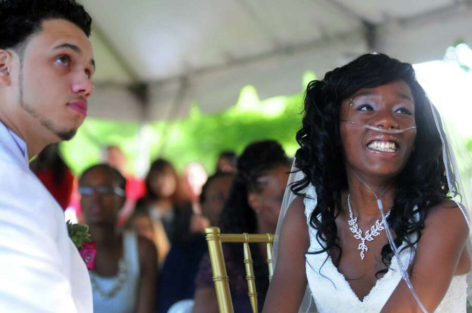 Jathyis Lajuett, left, and Jahaysia Graham are married at the Central Park Rose Garden Friday, Sept. 12, 2014, in Schenectady, N.Y. Nineteen-year-old Jahaysia is a patient of The Community Hospice. (Michael P. Farrell/Times Union) Photo: Michael P. Farrell / 00028581A