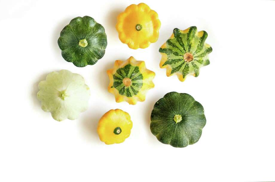 Disk-shaped scalloped squash is tender, with a delicate flavor. Photo: Russell Yip / Russell Yip / The Chronicle / ONLINE_YES