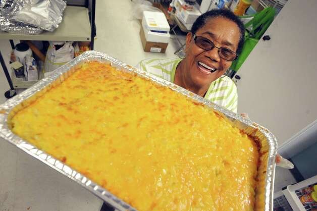 Clara Phillips holds up a tray of her recipe dish of macaroni and cheese for Mississippi Day eating on Friday Sept. 12, 2014 in Albany, N.Y. The Third Annual Mississippi Day will be held in Lincoln Park on Saturday from 11am-8pm with Mississippi themed food and entertainment. (Michael P. Farrell/Times Union) Photo: Michael P. Farrell / 00028604A