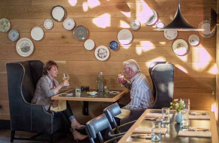 A couple dines at the English pub and Wine Country chic mashup Farmer and the Fox in St. Helena. Photo: John Storey, FRE / Special To The Chronicle / ONLINE_YES