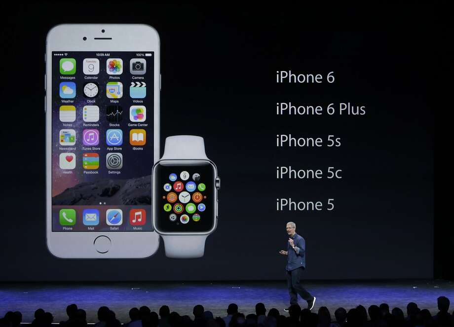 Apple CEO Tim Cook introduces Apple Watch and iPhone 6  on Tuesday, Sept. 9, 2014, in Cupertino, Calif. (AP Photo/Marcio Jose Sanchez) Photo: Marcio Jose Sanchez, Associated Press
