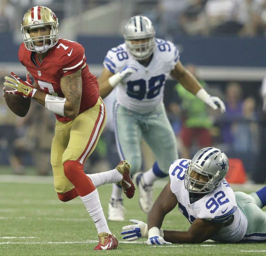 San Francisco 49ers quarterback Colin Kaepernick eludes the Dallas Cowboy defense in the season opener last week. After one bad showing, some fans are expecting the worst this year. Photo: LM Otero / Associated Press / AP