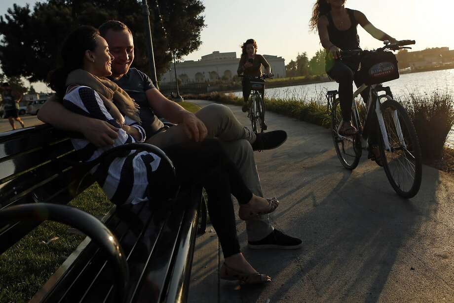 Nathan Brougher and Andrea Bustard enjoy the late afternoon sun while seated on a park bench along Lake Merritt in Oakland, Calif. on Wednesday, September 10, 2014. Photo: Scott Strazzante, The Chronicle