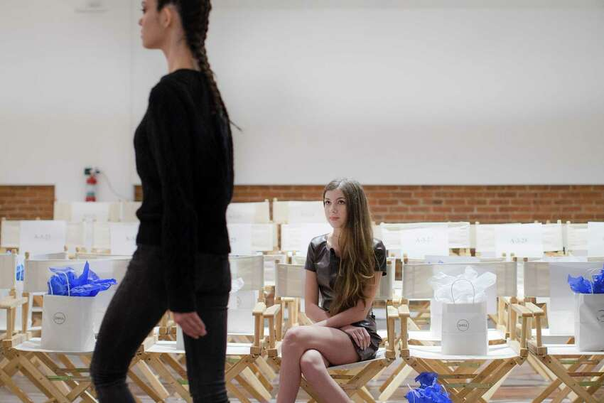 Designer Isabella Rose Taylor watches a rehearsal before her Spring 2015 collection is modeled during Fashion Week, Tuesday, Sept. 9, 2014, in New York.