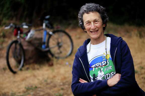 Marilyn Price, Trips for Kids founding director,  poses for a portrait with her bike, that she has had since the early 1980's and has gone on many a Trips for Kids bike rides, on Tuesday, August 19,  2014 in Mill Valley, Calif.