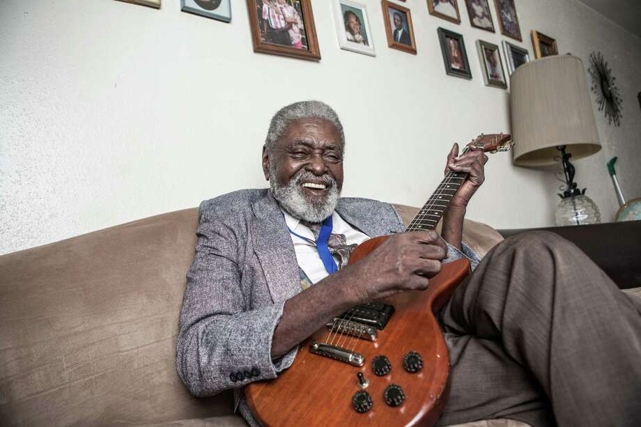 Jimmy Dotson, a Houston blues musician, poses for a portrait with his guitar in his home Friday September 12, 2014 in Houston, TX. (Michael Starghill, Jr.) Photo: Michael Starghill Jr., Photographer / © Michael Starghill Jr.