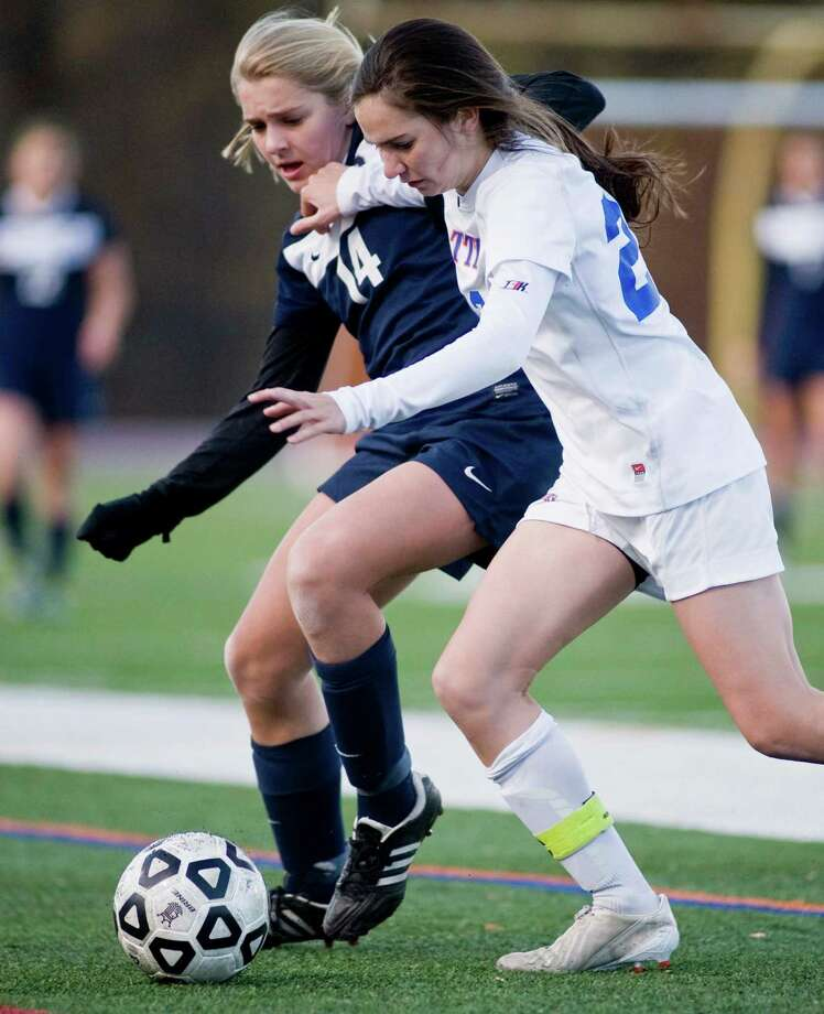 Staples High School's Lydia Shaw and Danbury High School's Olivia De Bellis shove each other in the Class LL state tournament game played at Danbury. Monday, Nov. 4, 2013 Photo: Scott Mullin / The News-Times Freelance