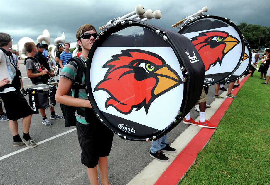 Dean Gothier peaks out from behind his drum during Lamar's marching band practice on Friday. The band was noted for exciting A&M's Kyle Stadium during last week's game. Photo taken Friday, September 14, 2014 Guiseppe Barranco/@spotnewsshooter Photo: Guiseppe Barranco, Photo Editor