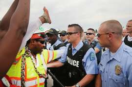 FERGUSON, MO - SEPTEMBER 10:  Police block demonstrators from gaining access to Interstate Highway 70 on September 10, 2014 near Ferguson, Missouri. The demonstrators had planned to shut down I70 but their efforts were thwarted by a large contingent of police from several area departments. Ferguson, in suburban St. Louis, is recovering from nearly two weeks of violent protests that erupted after teenager Michael Brown was shot and killed by Ferguson police officer Darren Wilson last month.  (Photo by Scott Olson/Getty Images)
