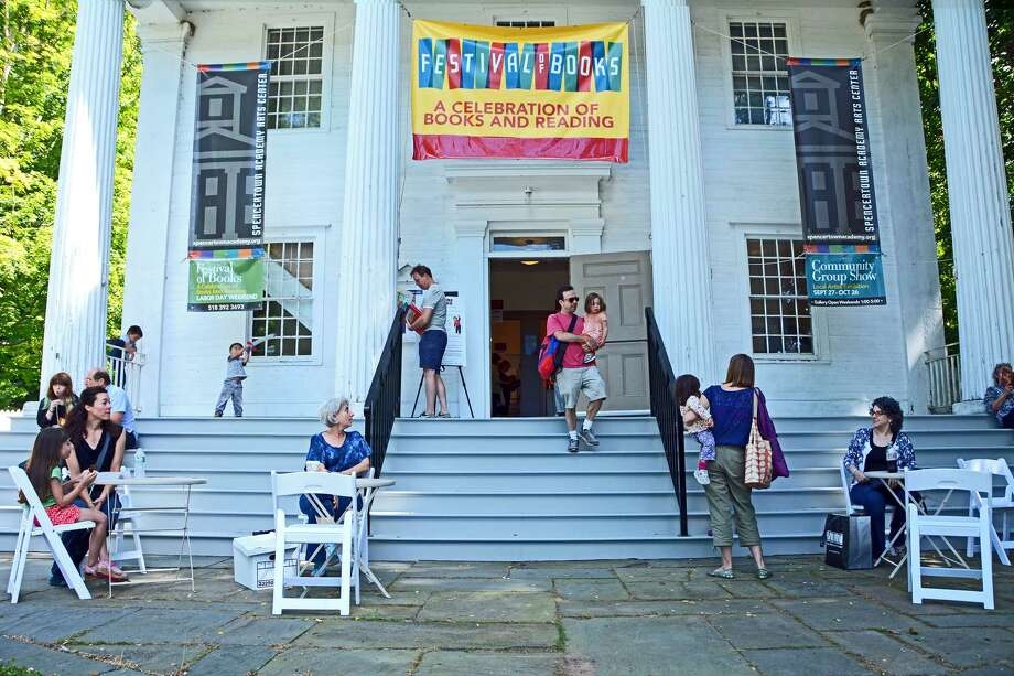Book lovers enjoy Spencertown Academy Arts Center?s Festival of Books over the Labor Day Weekend.  The festival was a record-breaker for the non-profit arts center selling more than 6,000 books, CDs and DVDs. More than 50 volunteers helped out. Lagonia Construction of Hillsdale recently completed the academy?s restored porch, steps and railing, seen above. (Photo by Peter Blandori)