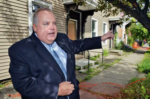 Executive Secretary of the Troy Housing Authority Dan Crawley explains the city's plans to develop abandon city-owned properties at 555 Second Avenue to house homeless veterans Friday Sept. 12, 2014, in Troy, NY.  (John Carl D'Annibale / Times Union) Photo: John Carl D'Annibale / 00028595A