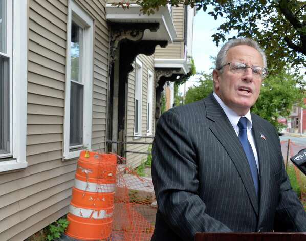 Mayor Lou Rosamilia announces the city's plan to develop abandon city-owned properties at 555 Second Avenue to house homeless veterans Friday Sept. 12, 2014, in Troy, NY.  (John Carl D'Annibale / Times Union) Photo: John Carl D'Annibale / 00028595A